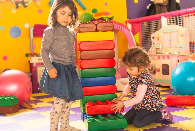Children stacking blocks | daycare negligence attorney